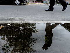 on duty (A. Yousuf Kurniawan) Tags: duty job work policeman walk reflection water puddle streetphotography urbanlife colourstreetphotography decisivemoment borneo kalimantan pangkalanbun indonesia silhouette