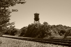 Huntersville NC water tower, railroad and Main St. (snow41) Tags: sepia huntersvillenc railroadtracks watertower
