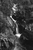 "looking upstream as the water gushes in long exposure towards the Lower Bridge behind the viewpoint, falls of Bruar, fine art black & white, Perth & Kinross, Scotland, UK (grumpybaldprof) Tags: canon 7d ""canon7d"" tamron 16300 16300mm ""tamron16300mmf3563diiivcpzdb016"" bw blackwhite ""blackwhite"" ""blackandwhite"" noireetblanc monochrome ""fineart"" striking artistic impressionist stylistic style contrast shadow bright dark black white illuminated ""longexposure"" ""perthandkinross"" pitlochry"" atholl"" ""robertburns"" ""dukeofatholl"" scotland uk ""fallsofbruar"" ""bruarwater"" waterfalls bridges ""glengarry"" ""lowerbridge"" ""upperbridge"" ""naturalarch"" trees forest paths walks water rocks stones arch path"
