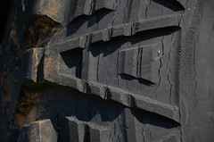 Tire tread (tao-of-m) Tags: tire tread rubber dirt cracked used shadows