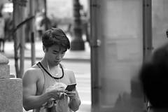 6-19 Candids 11 (TheseusPhoto) Tags: people candid blackandwhite blancoynegro noir bnw monochrome streetphotography street sanfrancisco california city citylife candids athletic guy hair phone face tanktop man