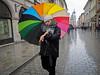 Krakow -3274178 (Neil.Simmons) Tags: poland krakow streetphotography people handbag coat street day woman women lady walk candid rain raining rainbow umbrella watch time