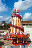 I'm Coming Down Fast, but I'm Miles Above You......... (clive_metcalfe) Tags: helterskelter stall amusement flags bunting clouds sky colourful colorful bournemouth dorset uk fun canon eos5dsr