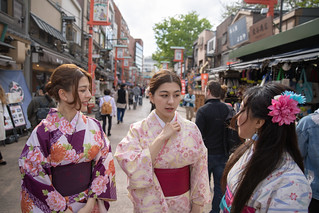 Young asian women talking on traditional Japanese street