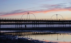 Staying till the End (JamieHaugh) Tags: southport liverpool merseyside england uk gb greatbritain outdoors sony a6000 sunset evening dusk pier pink purple sand beach coast seaside sea water sky clouds peace quiet silhouette figure person structure puddle reflections ilce6000 zeiss