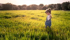 Spring is coming... (Bai R.) Tags: portrait girl child childhood green springtime spring joy grass sunset outdoors thoughtful play playing sun light