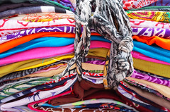 a stack of bright colored fabrics (alexkaven) Tags: cloth color fabric background textile fashion material cotton stack bright colorful design texture pattern abstract blue red clothing folded yellow collection market detail sale pile multi traditional retail craft orange soft silk striped art textured woven rainbow objects vibrant store garment india vivid colour blanket casual indian palette handmade industry