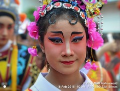 2018-02a Bangkok Chinatown (55) (Matt Hahnewald) Tags: matthahnewaldphotography facingtheworld live aesthetic springfestival chinesenewyear parade performer dancer makeup lunaryear festival head face painted eyes costume consent fun entertainment travel tourism culture tradition enjoyment socialevent diversity impact traditional cultural folklore touristattraction celebration historical yaowarat bangkok chinatown thailand thaichinese asia image photo faceperception physiognomy nikond3100 primelens 50mm 4x3 horizontal street portrait closeup outdoor color colorful posingforcamera iconic awesome incredible authentic sightseeing partying photography ambiguity attire eyemakeup softfocus seveneighthsview nikkorafs50mmf18g lookingcamera headshot