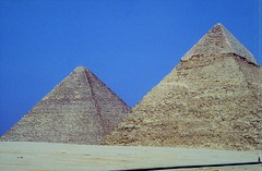 Giza (1991) (Henry Hemming) Tags: giza egypt pyramids sun cyclist empty two pair pyramidal tourism