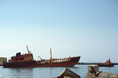 marine stories (raisalachoque) Tags: 7dwf sailing vessel big small old maritime horizon water boat tug tugboat ship sea seascape marine