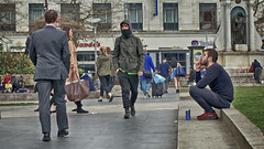 Slice o' life (Mick Steff) Tags: slice life manchester street urban trio three males piccadilly watching drinking walking people road pavement signs sitting smoking scarf