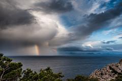 Storm out at sea (Peter Quinn1) Tags: mediterranean mallorca capdeformentor menorca storm rainbow cloudscape clouds bigsky outtosea passingstorm stormscape doublerainbow ch