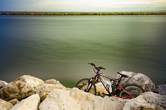 Cycle (Zahidur Rahman (Thanks for the Favs, comments and ) Tags: longexposure bike cycle bicycle composition water sky cloud skyline coast color lightshigh lightlow lightzahidur rahman stone object wheels green aqua bright shadow chair seat handle bottle real red stream flow shade lines curves explore travel run speed day afternoon beachside reflections mexico tampico landscape waterscape travelscape scape shot photo marine sea