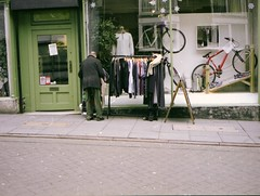 """2nd hand cloths. ... (Esmik D'Aguiar) Tags: fujiga645zi lomo urban man street shop cloths uk"