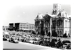 Parade in Weatherford, TX Square Downtown July 8, 1949 (sdwalden6) Tags: weatherford weatherfordtexas weatherfordsquare courthouse weatherforddowntown 1949 1940s 1950s july1949 photograph blackandwhite vintage old retro antique