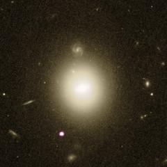Galaxy with Star-Shredding Black Hole (sjrankin) Tags: 19june2018 edited nasa galaxy xray chandra chandraspacetelescope 6dfgsgj2150222055059 j2150 hst hubblespacetelescope barredspiral spiralgalaxy blackhole