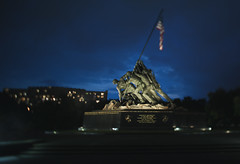 Iwo Jima at Night (Duluoz Me) Tags: tiltshift tilt shift canon 24mm tse 5d mark ii night light focus depth field booked summer scenic memorial usa america washington dc arlington virginia japan wwii world war two blue green flag stars stripes sky clouds spotlight miniature affect effect interesting composition magic slice city street landscape