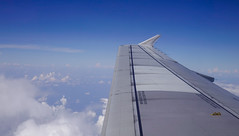An airplane wing through window (phuong.sg@gmail.com) Tags: aerial aeroplane aerospace air aircraft airline airplane altitude atmosphere aviation background beautiful cabin close closeup cloud cloudy copy copyspace earth flight fly frame glass high horizon jet journey looking nature passenger plane scenic sky space stratosphere tourism transport transportation travel trip vacation view voyage weather white window wing