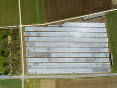 Bird's eye view of a field under foil (marcoverch) Tags: locationindependent phantom3 phantom dji travel luftbildaufnahme luftaufnahme reisen aerial aerialphotography reiseblogger digitalnomad bornheim nordrheinwestfalen deutschland de wood holz noperson keineperson architecture diearchitektur step schritt empty leer house haus building gebäude design wall mauer family familie wooden hölzern window fenster old alt expression ausdruck desktop construction konstruktion pictureframe bilderrahmen outdoors drausen urban städtisch shadow schatten colours bluesky classic child boats noiretblanc canal second dof silhouette birdseyeview field under foil