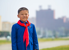 Happy kid, North Korea (TeunJanssen) Tags: northkorea portrait happy kid smile dof 75mm 75mmf18 communist dprk korea korean workersparty pyongyang ypt youngpioneertours olympus omd omdem10 backpacking travel traveling worldtravel
