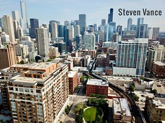 Say hello to the Brown and Purple Line trains (Steven Vance) Tags: chicago djimavicpro aerial l transit subway elevated brownline purpleline cta nearnorth