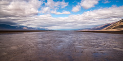 River of Mud (Kurt Lawson) Tags: badwater basin black california clouds copyrighted death mountains mud national panamint park range reflection river valley wind unitedstates