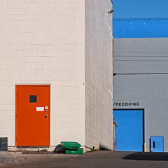 The flat side of town (pjwoodland) Tags: architecture building warehouse victoria victoriabc red blue doors walls industrialarea