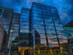 Dusk, Ottawa, Ontario, Canada (duaneschermerhorn) Tags: architecture building skyscraper structure highrise architect modern contemporary modernarchitecture contemporaryarchitecture reflection reflective reflectivebuilding glass windows glassclad mirror distortion colors colours colorful twilight clouds blue sky sunset rose red dark brooding