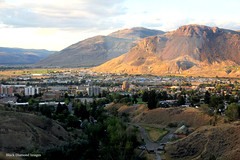 View over Kamloops to Mount Paul from the Rocky Mountaineer,  British Columbia, Canada (Black Diamond Images) Tags: kamloops vancouver britishcolumbia rockymountaineer rockymountaineerroute thompsonriver thompsonrivervalley thompsonrivercanyon thompsonrivergorge canadianrockies vancouvertokamloops canadiantourism armstronggroupltd goldleaf goldleafdomecoach train railroad railway travelphotography landscapes sky mountain mountainside landscape kamloopsrailwaystation mountpaul view canada
