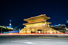 Dongdaemun Gate at night with light trails of Traffic in Seoul city, South Korea (MongkolChuewong) Tags: 2018 ancient asia asian attraction buildings cars castle city cityscape destination district dongdaemun downtown evening famous fast fotress gate gateway heunginjimun historic historical jam jongo korea korean landmark light market namdaemun night old one palace place road seoul skyline south street structure tail tourist traffic trails travel urban wall walled