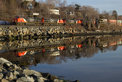Reflections of Days Gone By - Birch Cove, NS (CWentzell Photography) Tags: cn canadiannational canada railroad rail railway freight train reflection 2018 120 novascotia bedford birchcove motivepower locomotive locomotives stacker stacks containers sunny sky clear april