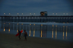 Night surfing at the pier in Oceanside California (Gail K E) Tags: oceanside oceansidepier california pacificocean socal nightreflection surfers usa
