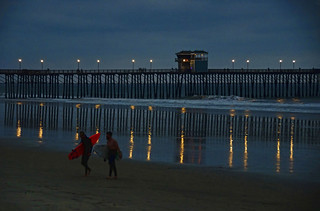 Night surfing at the pier in Oceanside California