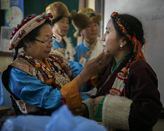 Backstage, getting ready for their performance. (Tenzin Samphel) Tags: tibetan women getting ready performance moments tibetanwomen traditional dress womenwear womenempowerment womensupportingwomen futureisfemale eventphotography tenzinsamphelphotography tibetanphotographer kathmandu nepal artistsoninstagram artist dancers