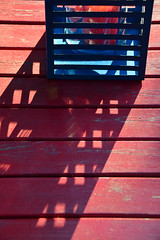 Solstice (James_D_Images) Tags: abstract wood table red blue candle lantern sunset long shadow summer solstice lines pattern geometry light