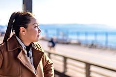 Women at Enoshima Electric Railway Kamakurakōkōmae Station (Dakiny) Tags: 2018 winter february japan kanagawa kamakura shichigahama city street beach sea railway enoshimaelectricrailway enoden station kamakurakōkōmaestation people portrait woman girl cigarette bokrh nikon d750 nikonclubit