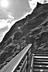 Stairway to ... (flowergirlaaa) Tags: englishheritage tintagel castle fence steps stairs stairway blackandwhite upwards flare sun