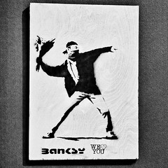 bansky tamed (khrawlings) Tags: banksy museum art manchester monochrome blackandwhite bw flowers protest spray stencil we love you heart