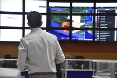 _DSC1026 (PDC Global) Tags: monitor track model predict observe emergencyoperations bigscreen largemonitor management maps map mapping gis geospatial display wall technology solutions software pdc tv television screen screens weather bright light office pc computer desktop laptop computers monitoring observing watching desks ndpba guatemala coen 2017 circular desk circle round paulo fernandes jr watch weatherwall