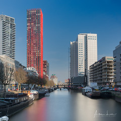 Nothing Attracts Attention Like A Red Dress II (Alec Lux) Tags: rotterdam apple architecture building canal city cityscape design holland landscape landscapephotography longexposure longexposurephotography netherlands red redapple reflection river skyline skyscraper structure urban water zuidholland nl
