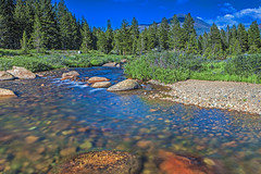 Mountain River and Stones in Yosemite National Park in California. Long Shutter Speed Used. Horizontal Image Orientation (DmitryMorgan) Tags: brook hdrimage hdrtoning landscape rapids stream usa yosemitenationalpark america american basin blue breathtaking california clam colorful enormous forest giant green highdynamicrange lake landmark mountain multiple national nature outdoor park peaks range remote rock scenery scenic sky summer sunny tourism tranquil travel unitedstates view vivid water