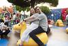 Riding a weird camel in Toon Park (roboppy) Tags: japan tokyodisneyresort tokyodisneyland urayasu chiba toontown toonpark kare robyn