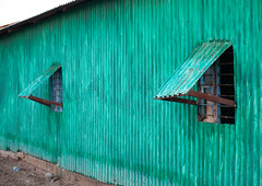 A run down metal house made from corrugated iron painted in green, Awdal region, Zeila, Somaliland (Eric Lafforgue) Tags: africa architecture awdal buildings colourimage developingcountry eastafrica green horizontal hornofafrica house metal nopeople outdoors photography residentialbuilding rundown simplicity slum soma6423 somalia somaliland zeila awdalregion
