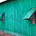 A run down metal house made from corrugated iron painted in green, Awdal region, Zeila, Somaliland