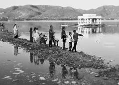 India: Jaipur. Throwing stones into Man Sagar Lake. (icarium82) Tags: india travel jaipur mansagarlake sonydscrx1rm2 blackandwhite bw bnw encounters street people lake water reflection sundaylights