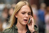 Candid Chat (Stuart Mac) Tags: candid street portrait woman d700 135mm f2 chat talking mobile face blonde dof