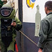 Sailors and Marines conduct a mock EOD sweep aboard the USS Wasp