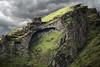 Rock at Skarðshlíð (wyojones) Tags: peak summersgreen skarðshlíð eyjafjöll southiceland iceland cliffs coast spire arch earlysettlers caves elves trolls clouds cloudscape