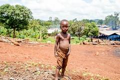 POA-H18_7142 (Carl LaCasse) Tags: pearlsofafrica uganda people children smile eyes jinja gin distillery fire smoke