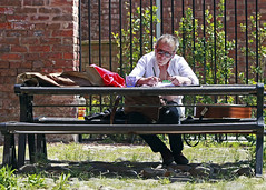 Small town troubadour (Mick Steff) Tags: writing sitting guitar solo one male manchester street urban people glasses reflection